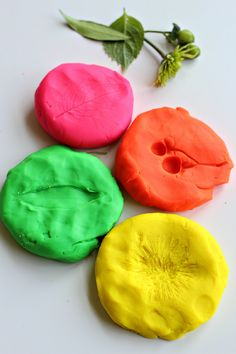 Nature prints – go on a nature hunt and come back and explore it by making nature prints using Play-Doh.
