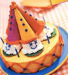 Ice cream, cones, and cookies decorate this clown cake. Serve it for dessert at a circus party for kids.