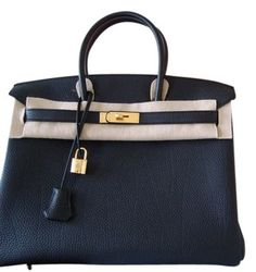 Herms Birkin 35cm Black Tote Bag. Get one of the hottest styles of the season! The Herms Birkin 35cm Black Tote Bag is a top 10 member favorite on Tradesy. Save on yours before they're sold out!