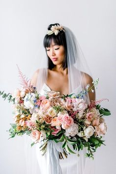 embellished slip wedding dress with pink tinted veil and lush bouquet
