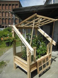 Greenhouse with salvaged windows Window Greenhouse, Small Greenhouse, Greenhouse Gardening, Greenhouse Ideas, Garden Structures, Outdoor Structures, Garden Huts, Modern Greenhouses, Cold Frame