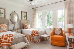twin beds, orange + taupe pallete