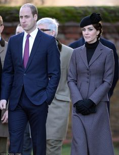 Kate and William watch the wreath laying after attending the Sunday service at the church ...