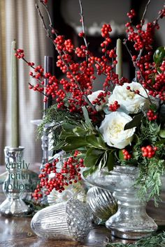 White roses, red berries, and greenery... Beautiful!