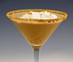Samoa Cookie Martini  1 oz. Godiva White Chocolate liqueur  1 oz. Vanilla Vodka  1 oz. Butterscotch Schnapps  1/2 oz. Coconut Milk  1 oz. Heavy Cream  Toasted sweet coconut flakes  Crushed Samoa Girl Scout Cookies (optional)  Chill a martini glass in the freezer or fill it with ice for several minutes, then discard the ice. In a shaker with ice, add vodka and all other liquid ingredients. Make a rim of coconut on a martini glass by dipping into the coconut milk then into the coconut flake