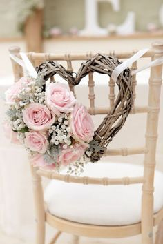 Shabby Chic Wedding Chair Decoration with Branch Heart and Pastel Fresh Flowers.