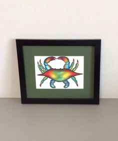 Watercolored Blue Crab Framed Painting by GulfLifebyNichole,