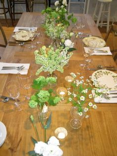 Antique glass vases with white & green flowers