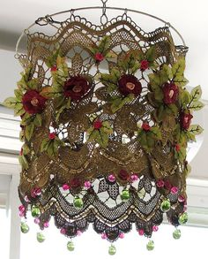 Anat Bon's lampshade is made of lace, knitted flowers, green fabric leaves, and several kinds of beads. Just gorgeous!