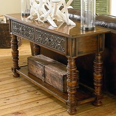 Console Table. Old World European inspired design crafted from pine solids and pine veneers and features an Antiqued Vineyard Pine distressed finish accented with Antique Patina Brass hardware.
