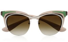 Prada creates fabulous sunglasses, and this retro looking pair is made from green acetate, with shiny silver