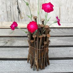 Quick and easy (and green!) diy decorating idea for fall flowers made with rusty nails.