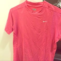Pink Nike shirt Very soft and great for long distance running. Sorry for the wrinkles...I've been moving. Offers welcomed! Nike Tops Muscle Tees