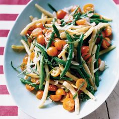 This supersimple bean-and-tomato salad, tossed with a tarragon-flavored dressing, is perfect for summertime picnics, like the kind Paul Virant's mothe...
