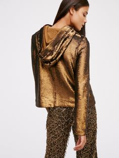 Hooded Sequin Jacket | Glam hooded jacket featuring eye-catching sequins allover. Side pockets. Front snap button and zipper closure. Lined.