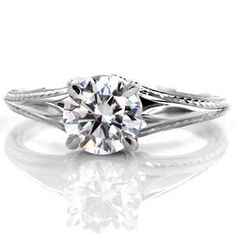 This custom solitaire engagement ring features a round brilliant cut diamond displayed in a knife edge band. #knoxjewelers #ring  www.knoxjewelers.biz