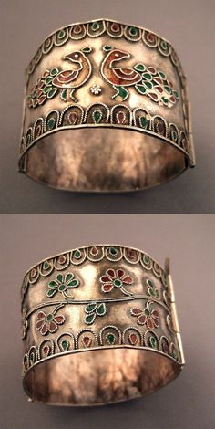 Egypt | Silver, enamel | This old Bedouin  silver and enameled bracelet was worn by the bride and, as a part of their personal dowry. | ca. 1st half 20th century | perfectly wearable… the floral and bird motives are current in Muslim culture with differences and specifities following the areas they are coming from | 600€