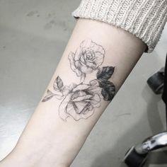 Roses on forearm by Tattooist Flower