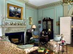 See the luxurious, intricate molding along the walls of this bright blue living room on HGTV.com.