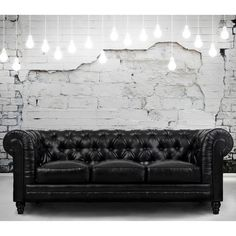 Comfort and style define the Zahara black leather sofa. A modern interpretation of the classic Chesterfield design, this handcrafted quality sofa features a solid kiln dried wood frame, and duck down