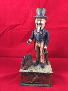 Antique Cast Iron Mechanical Bank:  Uncle Sam with Box...Primitive Rustic Historical Vintage Country Store USA Figurine Coins Money Savings by buckeyeantiques on Etsy