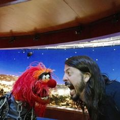 Foo Fighters frontman and former Nirvana drummer Dave Grohl dukes it out with The Muppets' Animal in a ferocious drum battle.