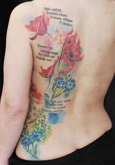 Colorful, feminine tattoo on womans back.  Artist Janis Andersons  #flowers #flowertattoo #poppies #cornflowers #watercolor #realistic #poetry #text #writing #womantattoo #backtattoo #riga #tattooinriga #tattooed #tattooist #tattooart #art #tattooink  #ink #inked #skin #tattooartist #tattoofrequency #share #like #follow