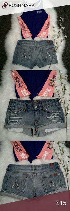 """7 for all mankind 28"""" Rhinestone Distress Shorts Excellent rebuild condition  Shorts have been cut, frayed & distressed for style 98% cotton-2% polyurethane Waist: 15.5"""" (relax laying flat from left to right) Length: 10.5"""" (frayed) 9.5"""" (folded) Front rise: 8 Wear 2 ways Frayed or Folded for 2 Different Styles 7 For All Mankind Shorts Jean Shorts"""