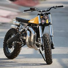 It's time for our Bikes Of The Week, and this killer two-stroke Yamaha scrambler heads the list. It's a super-light 210 pounds of tweaked RD350 insanity. The builder is Arjun Raina of Moto Exotica, and he's added a custom swingarm, KTM 200 suspension and a complete new seat, tank and tail section. Check the exhaust: it's been TIG welded from 45 separate sections, including those gorgeous, stainless steel expansion chambers Hit the link in our bio to see four more killer builds that caught...