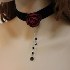 "- Product Info - Product Care - Shipping This black velvet ribbon choker necklace is my take on romantic Victorian! A pretty 1.5"" red felt flower has been sewn on to the side of the choker as the foca"