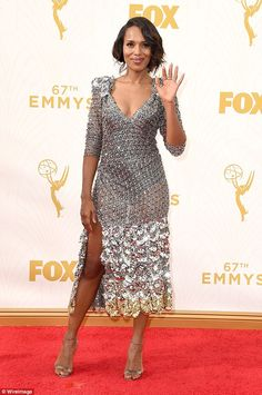 Slinky:The Scandal star stood out in a sexy silver dress on the Emmy carpet. Not only did it plunge in the front, but she had a racy slit up the side, showing off toned pins