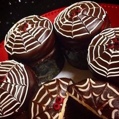 Black Widow cupcakes, devils food cake frosted with cream cheese icing dipped in ganache & a web design with red widow eyes.....spooky & delicious!