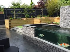 We designed this koi pond with a cut out wall to view the fish