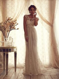 Sheath/Column Scoop Sweep/Brush Train Tulle Bridal Gown With Applique