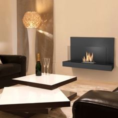 Alden Bio Ethanol Fireplace by Imagin. Great design, simple and elegant heater that offers a stylish design combined with ease of use and requires no installation. Use with any good quality Bio-Ethanol fuel. Biofuels fuel burn cleanly, producing no odour and no smoke, only heat. Manufactured from Powder coated iron, with glass and a stainless steel burner. Dimensions: (H)500, (W)900, (D)230mm. Matt black finish Heat output: Approx 2kWh. Flue type: No chimney or flue required. Around £299