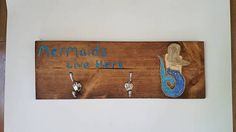 Check out this item in my Etsy shop https://www.etsy.com/listing/521727766/mermaids-live-here-hook-rack-towel-hooks