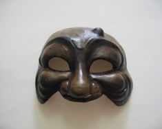 This is the Arlecchino's Mask. It is reminiscent of  a cat's face; pretty features with a twist of evil. The nose is not very long because the Arlecchino was among the smarter stock characters.