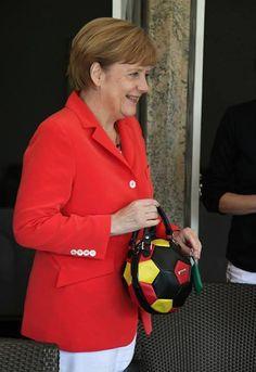 Frau Merkel and fancy handbag WC 2014
