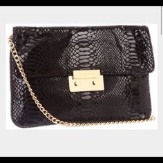 Michael Kors Sloan Python Evening Bag Authentic Michael Kors embossed python leather evening back with gold chain strap that can be tucked into back pocket to make it a clutch.  This is perfect for the upcoming holiday season. The latch has some minor scuffing but otherwise this bag is ready to party.  Clean inside and out.  The interior has lots of credit card slots, a zippered and can hold all the essentials. Michael Kors Bags Clutches & Wristlets