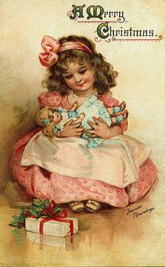 .The love of a little girl for her new baby doll at Christmas