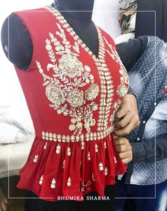 Gorgeous red color peplum top with floral design hand embroidery thread and kundan work. Peplum Top Outfits, Red Peplum Tops, Peplum Blouse, Choli Designs, Saree Blouse Designs, Kids Ethnic Wear, Wedding Saree Collection, Indian Costumes, Indian Gowns Dresses