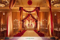 Shawna Yamamoto Event Design Mandap at Four Seasons Las Vegas, red and cream color scheme, romantic dark lighting, hanging florals, petal aisle, indoor wedding ceremony