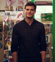 Such a sweet smile as Fifty enters Clayton's. Jamie Dornan.