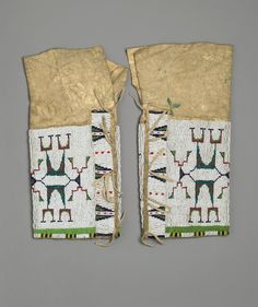 Lakota, Sioux (Native American). Woman's Leggings, ca. 1870-1895. Hide, metal, beads, 15 x 8 in.  (38.1 x 20.3 cm). Brooklyn Museum, Charles Stewart Smith Memorial Fund, 46.96.10a-b. Creative Commons-BY (Photo: Brooklyn Museum, 46.96.10a-b_PS2.jpg)