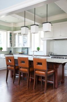 Love the backsplash tile, kitchen ceiling architecture, high windows, color carried throughout house