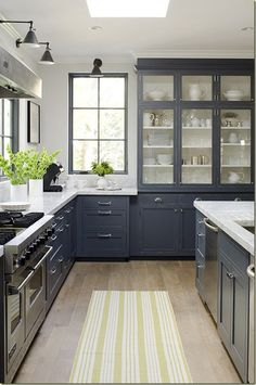 Gray blue cabinets   white counters.