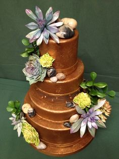 Chocolate Wedding cake with Succulents and Stones.