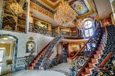 exterior: Stunning Crystal Chandelier Hung Above Wonderful Ladder With Beautiful Rug On It Installed Inside Expensive Extravagant Houses With High Ceiling Ideas - Inspiring Extravagant Houses with Charming Exterior Design, Luxury Busla: Home Decorating Ideas and Interior Design