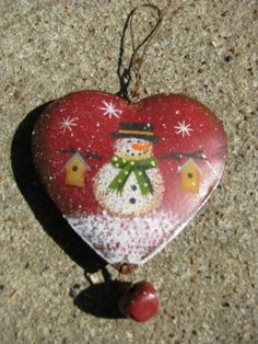 "OR-509 Snowman/Birdhouses   3 1/2"" x 3""  Metal Heart Ornament    $ 1.50"