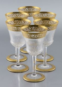 """St. Louis """"Thistle"""" pattern burgundy wine goblets, the lip and foot with gilt bands, the body and stem with cut and etched decoration. Acid etched stamp, """"Cristal St. Louis France"""". 6.375"""" H, Circa 20th C."""
